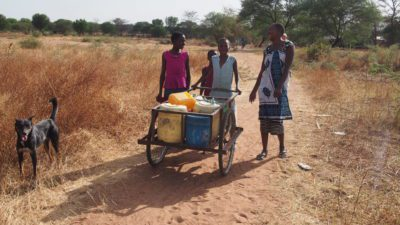 Water girls delivering from a distant source